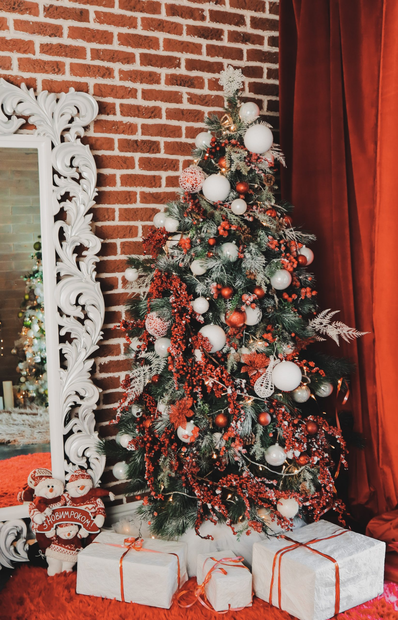 A red and white themed Christmas tree décor featuring a wide array of decorative elements.