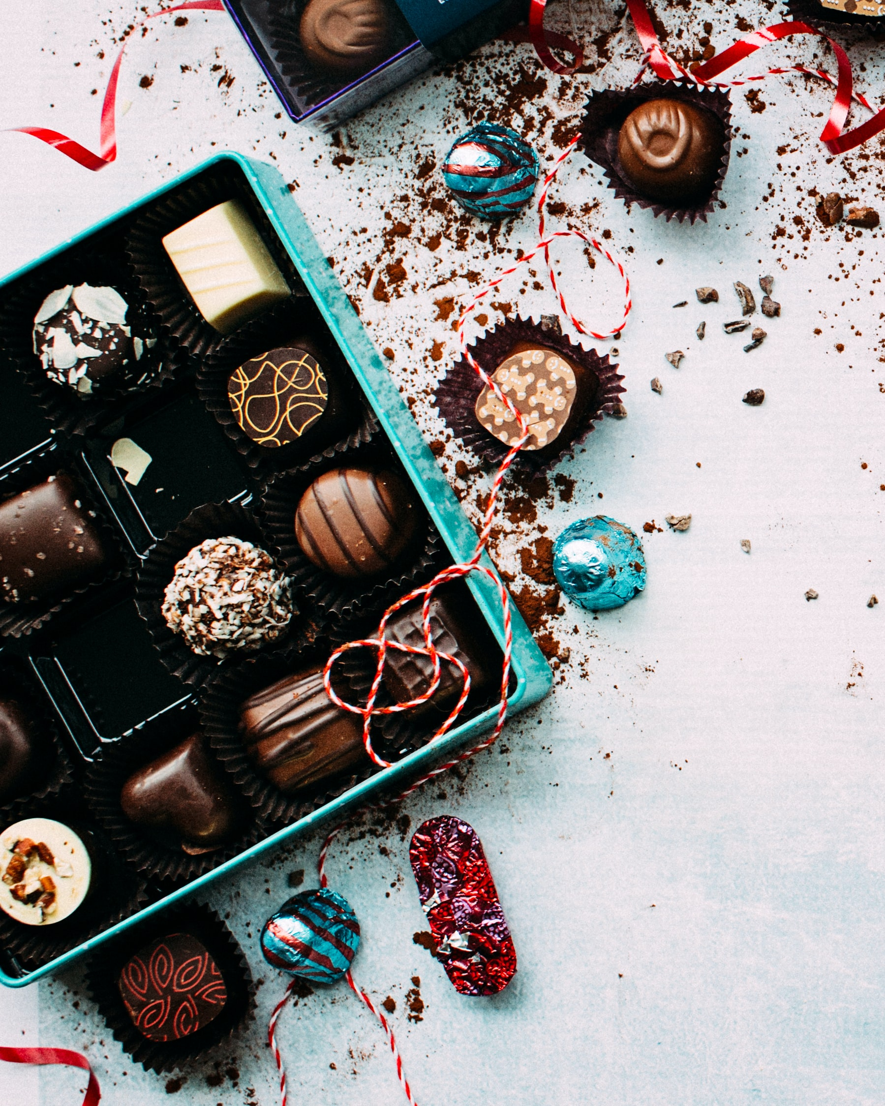 A box of assorted chocolates in different shapes and patterns