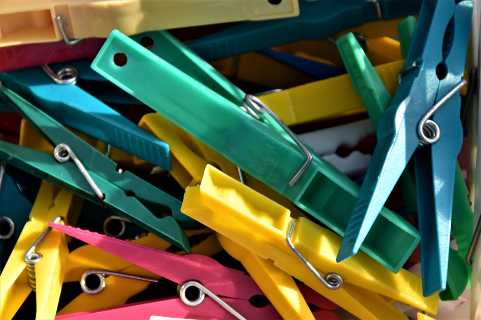 Different colors of clothespin put together.
