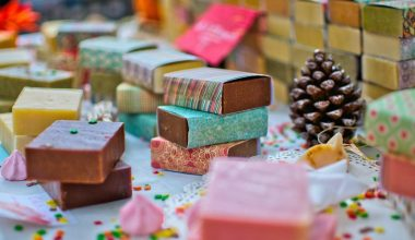 Numerous different kinds of handmade soaps placed together in a colorful setting.