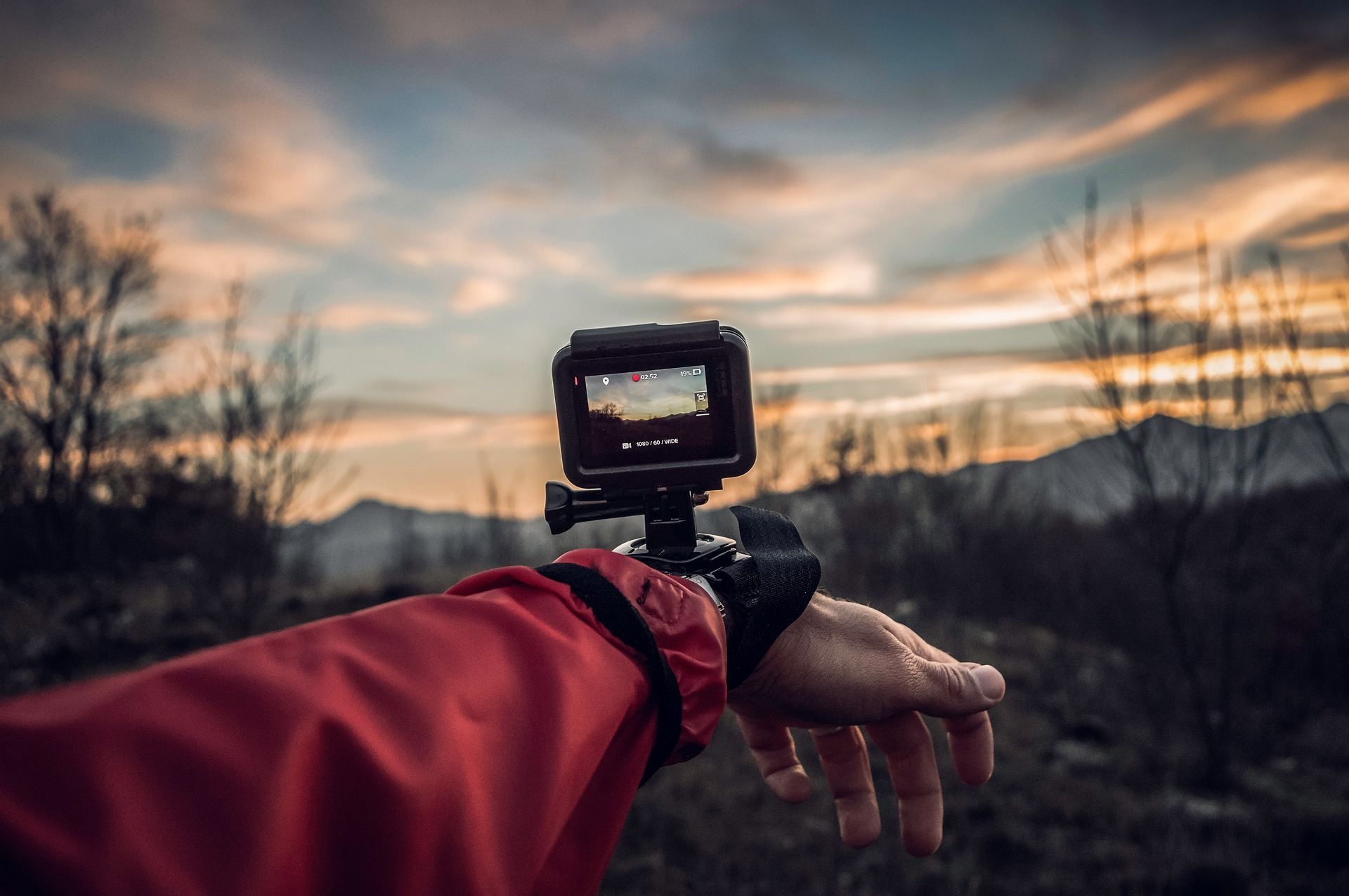 The hand of an athlete wearing a GoPro camera.
