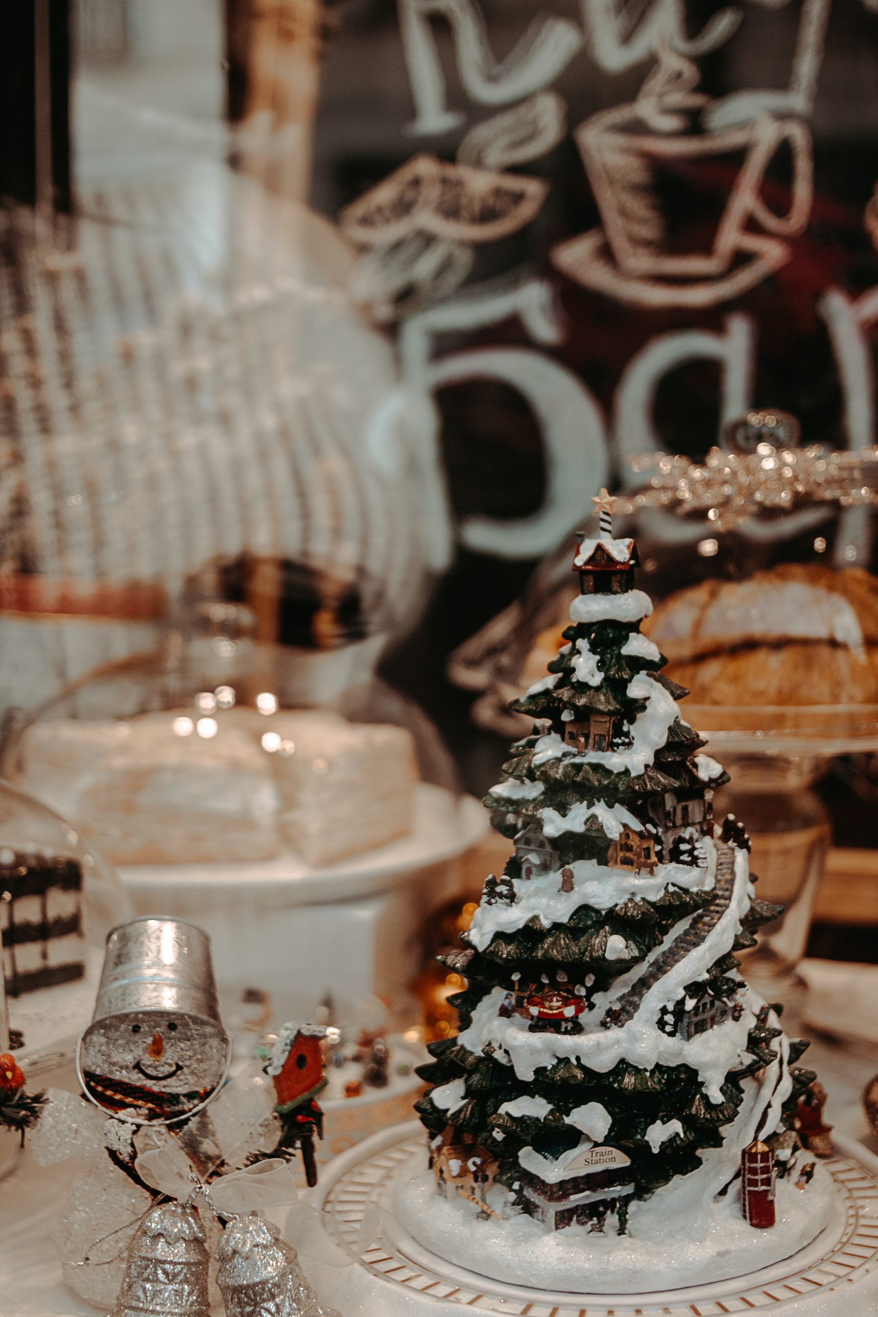 A miniature Christmas tree surrounded by other Christmas-themed ornamentation at a winter wedding