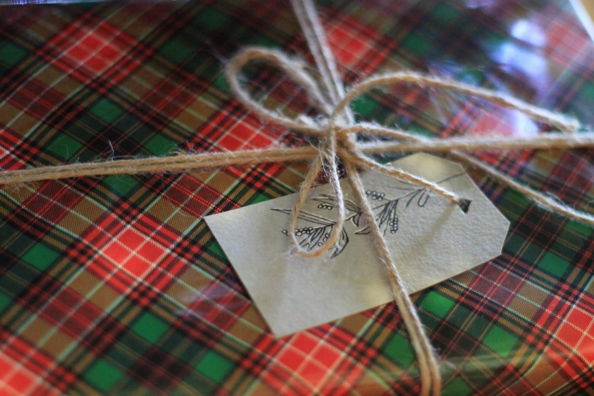 A gift wrapped in buffalo plaid Christmas wrapper.