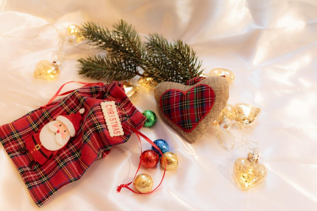 Buffalo plaid checkered Christmas ornaments in different color combinations, including blue, black, red, green, brown, and white and different shapes