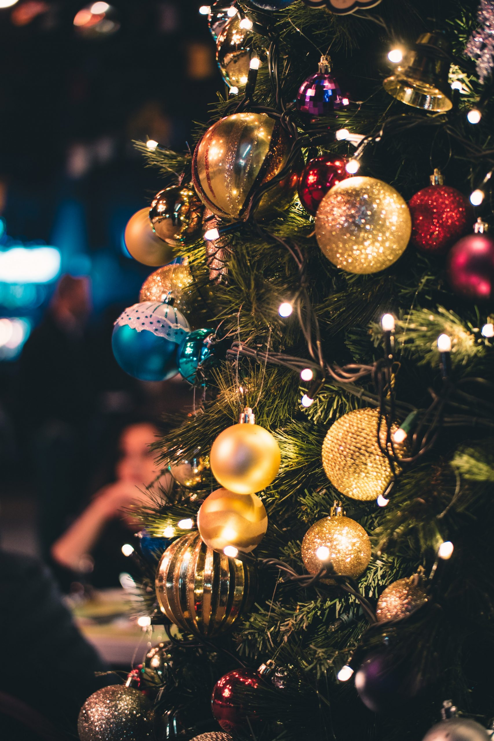 A Christmas tree decorated using a variety of baubles or balls.
