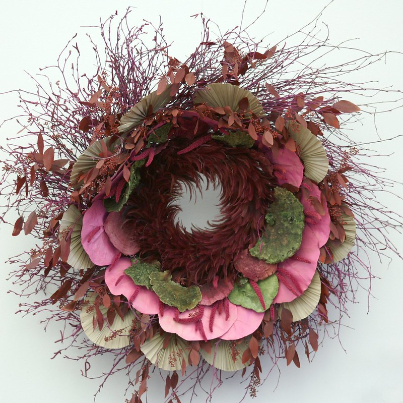 A Christmas wreath with dried flowers and leaves designed in a pattern