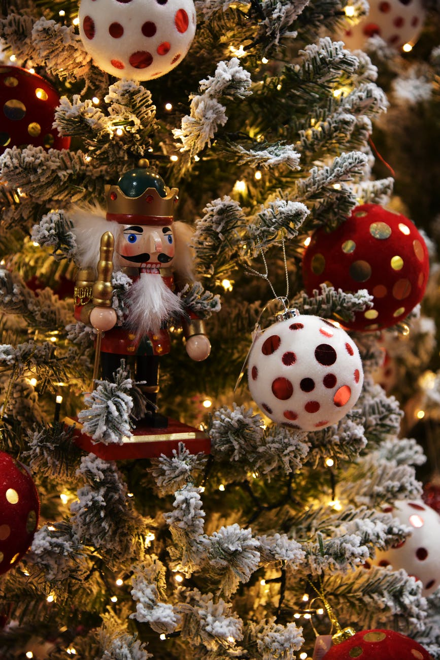 A nutcracker ornament on a Christmas tree