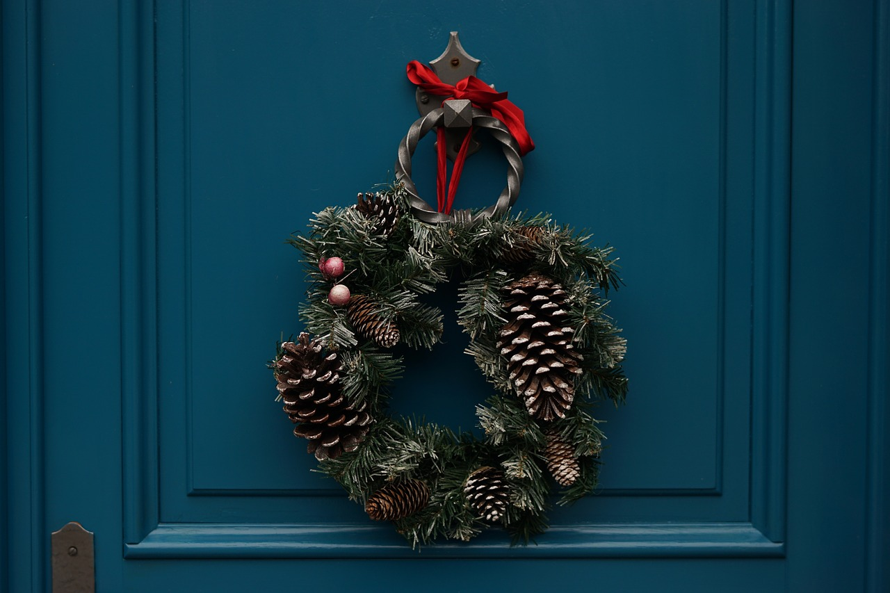 A rustic Christmas wreaths with silver pinecones