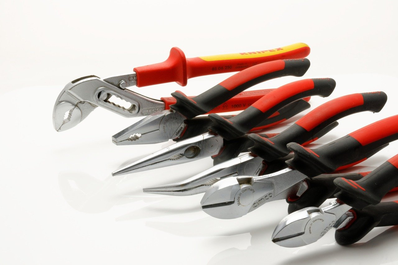 Six diagonally laid out wire cutters of different shapes to be used for different purposes.